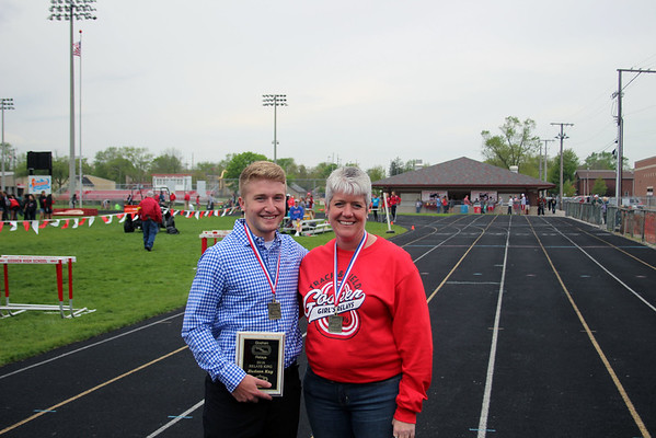 GREG KEIM | THE GOSHEN NEWS<br /> Hudson Kay, left, was crowned King of the 27th annual Goshen Girls Relays Saturday at Foreman Field in Goshen. Kay is pictured with Dawn Hicks, who served as the Honorary Referee for the event.