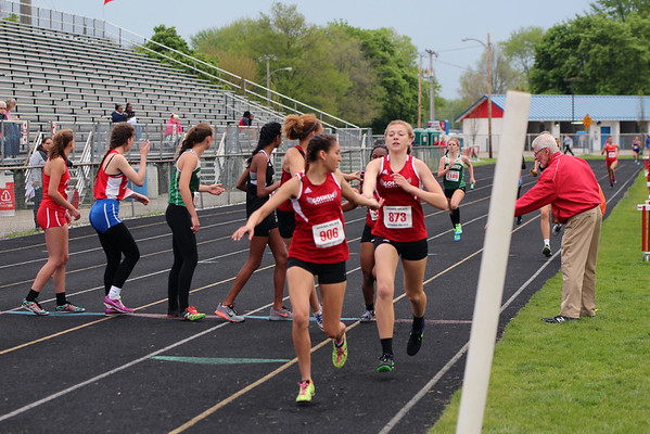 GREG KEIM   THE GOSHEN NEWS<br /> Nora Rangel, No. 906 of the Goshen RedHawks takes the baton from No. 873 Maggie Gallagher in the in the Class A 4 x 400-meter relay Saturday at the Goshen Girls Relays.