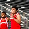 SAM HOUSEHOLDER | THE GOSHEN NEWS<br /> Goshen senior runner Abe Medellin runs a 100-meter dash heat during the meet against Concord and Plymouth Thursday.