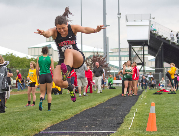 SAM HOUSEHOLDER | THE GOSHEN NEWS<br /> NorthWood sophomore Breanna Troyer jumps during the long jump Tuesday at the NLC Championship meet at Warsaw High School.