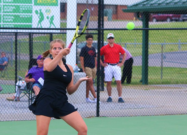 Northridge No. 1 singles player Riley Wheatley returns a shot back to Angola's Elina Locane during Tuesday's regional semifinals at Northridge High School.