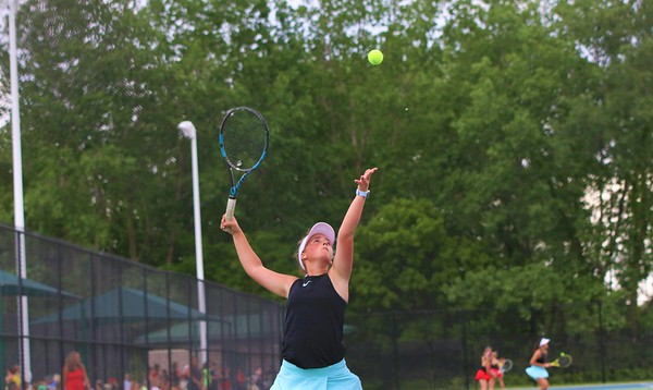 Fairfield No. 1 singles player Addison Mast serves during Tuesday's regional semifinals against Westview's Paige Riegsecker at Northridge High School in Middlebury.