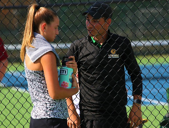 Northridge coach Austin Christner talks with No. 2 singles player Lilah Dean during a stoppage in play at Wednesday's regional final against Fairfield in Middlebury.