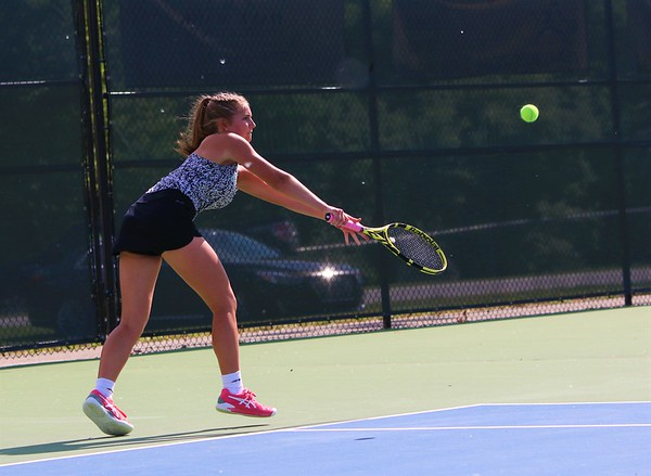 Northridge No. 1 singles player Riley Wheatley reaches out for a ball during Wednesday's regional final against Fairfield at Northridge High School in Middlebury.