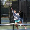 Northridge No. 1 singles player Riley Wheatley reaches high to hit the ball during her semistate match against Homestead Saturday at Homestead High School in Fort Wayne.