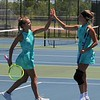The No. 1 Northridge doubles team of Brynne Gayler, left, and Peyton Kieper go for a high-five during their semistate match against Homestead Saturday at Homestead High School in Fort Wayne.