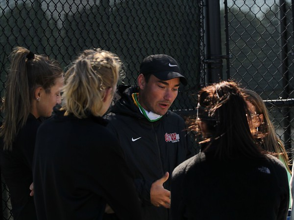 Northridge girls tennis coach Austin Christner, center, gives a pre-match speech to his team ahead of their semistate match against Homestead Saturday at Homestead High School in Fort Wayne.