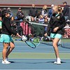 The Northridge No. 2 doubles team of Taylin Cress, left, and Morgan Mack touch rackets during their semistate match against Homestead Saturday at Homestead High School in Fort Wayne.