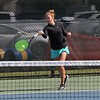 Northridge No. 2 singles player Lilah Dean hits a forehand shot during her semistate match against Homestead Saturday at Homestead High School in Fort Wayne.