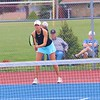 Fairfield's Iris Miller awaits a serve during No. 1 doubles play at the NECC Tournament in Ligonier on Saturday.