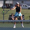 Fairfield junior Faith Bontrager hits a return shot during her No. 2 singles match in the first round of the NECC girls tennis tournament Thursday at Lakeland High School in LaGrange.