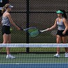 Northridge junior Morgan Mack, left, and Taylin Cress tap rackets after winning the first set of their No. 2 doubles match against Goshen's Tori Barkey and Abril Diaz in the NLC Tournament Wednesday in Nappanee.
