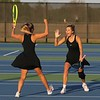Northridge senior Peyton Keiper, right, and senior Brynne Gayler go for a high-five after winning the No. 1 doubles championship at the NLC girls tennis tournament Friday at NorthWood High School in Nappanee.