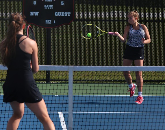 Northridge senior Riley Wheatley, right, delivers a forehand winner past Warsaw senior Paige Zawadski in Wheatley's 6-0, 6-0 victory in the first round of the No. 1 singles tournament at the NLC Tournament Wednesday at NorthWood High School in Nappanee.
