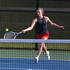 Goshen sophomore Mara Schrock goes to hit a shot during her No. 2 singles match against Wawasee senior Casey Yankosky in the NLC Tournament opening round Wednesday at NorthWood High School in Nappanee. Schrock won, 6-0, 6-2.