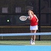 Goshen sophomore Mara Schrock returns a serve against Concord junior Claire Steele during singles play on Wednesday at Concord High School in Elkhart.