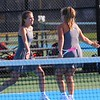 Concord's Addi May, left, gives her teammate Maggie Burkert a high five after earning a point during doubles play on Wednesday at Concord High School in Elkhart.