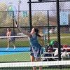 Concord senior Rylee Brenneman serves during singles play against Goshen senior Lucy Kramer on Wednesday at Concord High School in Elkhart.