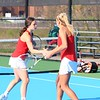 Goshen's Joya Drenth, left, celebrates with teammate Kathryn Detweiler after winning a point during doubles play on Wednesday at Concord High School in Elkhart.