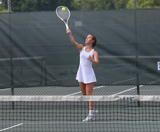 Goshen senior Joya Drenth serves the ball during her and Kathryn Detweiler's match at the state individual doubles tournament Friday at North Central High School in Indianapolis.