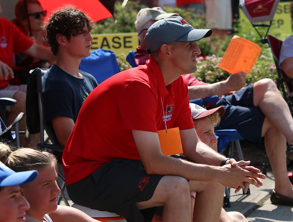 Goshen tennis coach Daniel Love looks on during the state individual doubles tournament Friday at North Central High School in Indianapolis.