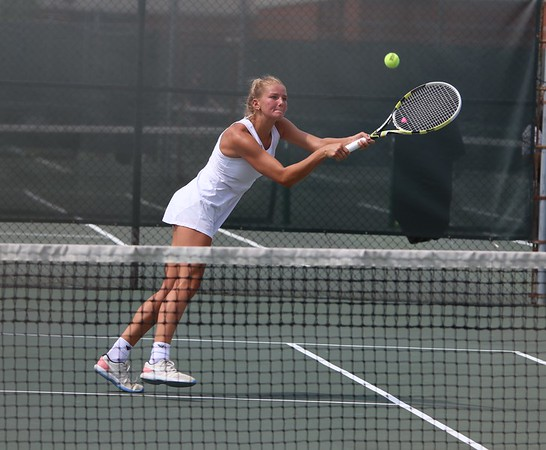 Goshen senior Kathryn Detweiler extends to hit the ball during her and Joya Drenth's match at the state individual doubles tournament Friday at North Central High School in Indianapolis.