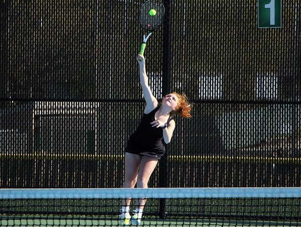 NorthWood's Gabriella Umbower serves the ball during her victory at No. 1 singles against Concord Friday at Concord High School in Elkhart.