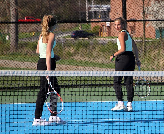 Concord's Kate Steele, right, looks back at her teammate, Gracie Westlake, during their win at No. 1 doubles over NorthWood Friday in Elkhart.