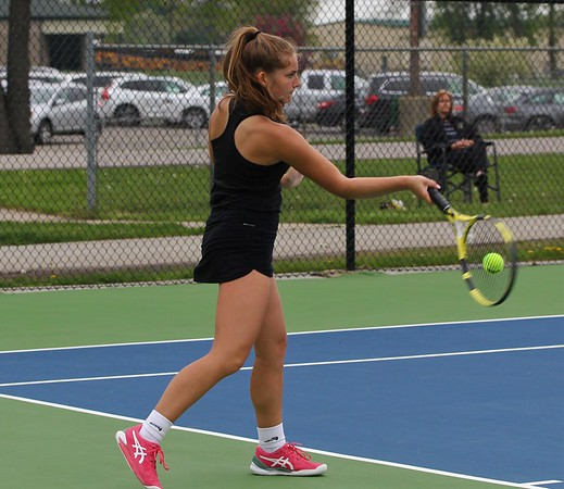 Northridge senior Riley Wheatley connects on a forehand shot during her No. 1 singles match against Penn Monday in Middlebury.