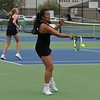 Northridge senior Maia Schmucker hits a forehand shot during her No. 3 singles match against Penn Monday in Middlebury.