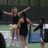 Northridge senior Brynne Gayler, background, leaps for joy as her teammates rush to celebrate after Northridge beat Penn; 3-2, in a girls tennis match Monday at Northridge High School in Middlebury. Gayler and her No. 1 doubles partner, senior Peyton Kieper, won the decisive match of the contest.