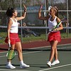 Westview senior Hallie Mast, left, and sophomore Ella Clark go for a high-five after scoring a point in their match against Fairfield Thursday in Goshen.