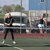 Fairfield senior Krystal Yoder, right, serves the ball while her teammate, senior Paige Simmons, looks on during their match against Westview Thursday in Goshen.