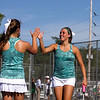 SAM HOUSEHOLDER   THE GOSHEN NEWS<br /> Northridge No. 1 doubles players Courtney Clark, right and Emily Erekson high five during their match Wednesday at Elkhart Central High School.