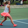 STEPHEN BROOKS   THE GOSHEN NEWS<br /> NorthWood senior Sydney Wysong winds up for a backhand shot in the No. 1 singles match of Tuesday's meet at Goshen. The Panthers won 4-1.