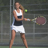 HALEY WARD   THE GOSHEN NEWS<br /> Fairfield No.1 doubles player Sidney Hochstedler hits a backhand during the Regional Championship match against Elkhart Memorial on Wednesday at Elkhart Central High School. Fairfield lost 2-3.