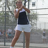 HALEY WARD   THE GOSHEN NEWS<br /> Fairfield No.3 singles player Margie Stutzman hits a backhand during the Regional Championship match against Elkhart Memorial on Wednesday at Elkhart Central High School. Stutzman won 6-0, 6-0, but Fairfield lost the match 2-3.