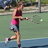 STEPHEN BROOKS | THE GOSHEN NEWS<br /> Goshen junior Kayleigh Crowder hits a backhand shot in the No. 1 singles match of Wednesday's sectional opener against NorthWood. NorthWood won 5-0 to advance to the sectional semifinals.
