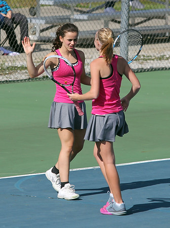 STEPHEN BROOKS   THE GOSHEN NEWS<br /> Goshen doubles players Ali Miller and Liz Erickson high-five after scoring a point during Wednesday's sectional opener against NorthWood. NorthWood won 5-0 to advance to the sectional semifinals.