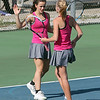 STEPHEN BROOKS | THE GOSHEN NEWS<br /> Goshen doubles players Ali Miller and Liz Erickson high-five after scoring a point during Wednesday's sectional opener against NorthWood. NorthWood won 5-0 to advance to the sectional semifinals.