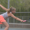 HALEY WARD | GOSHEN NEWS<br /> NorthWood No.1 singles player Sydney Wysong reaches for the ball against Fairfield during the Sectional Tennis Championship on Friday at Goshen Middle School. Wysong lost 6-2, 6-4.