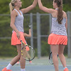 HALEY WARD| THE GOSHEN NEWS<br /> NorthWood sophomore Kennedy Wiens (left) and junior Jama Rice (right) high five after scoring against Fairfield during the Sectional Tennis Championship on Friday at Goshen Middle School. The NorthWood No.1 doubles team won 6-2, 6-1.