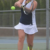 HALEY WARD | THE GOSHEN NEWS<br /> Fairfield senior Emily Mast hits a backhand against NorthWood during the Sectional Tennis Championship on Friday at Goshen Middle School. Mast won her No.1 singles match 6-2, 6-4.