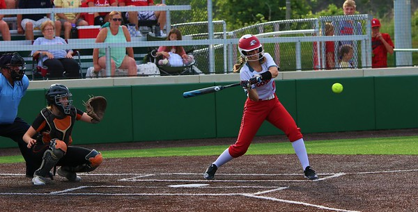 Goshen's Emma Detwiler swings at the plate during Monday's Class 4A Sectional 4 opener against Warsaw at Northridge High School in Middlebury.