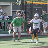 Northridge assistant coach Andy Robinson encourages sophomore Jasmin Bell as she heads home during a productive 3rd inning against Concord in sectional action Wednesday evening in Middlebury