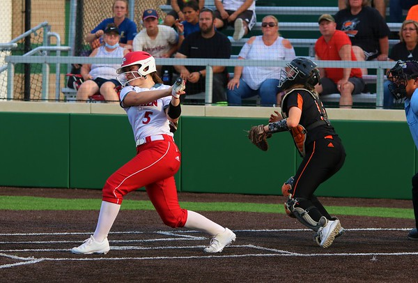 Goshen's Jenna Roll fouls off a pitch during Monday's Class 4A Sectional 4 opener against Warsaw at Northridge High School.