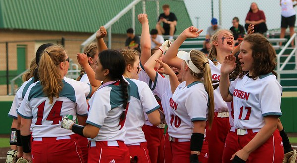 The Goshen RedHawks softball team huddles near the dugout late in Monday's Class 4A Sectional 4 matchup against Warsaw at Northridge High School in Middlebury.