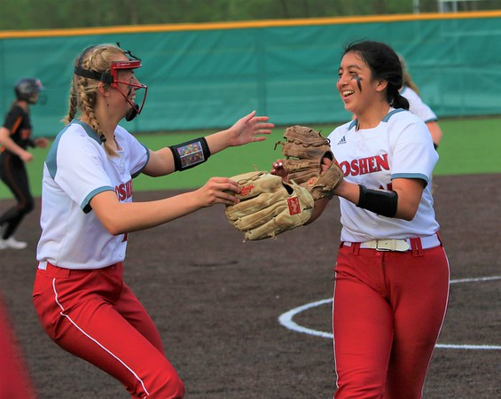 Goshen's Tyra Marcum, left, and Liz Ramirez celebrate after beating Warsaw to advance during Monday's Class 4A Sectional 4 opener at Northridge High School in Middlebury.