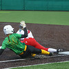 Northridge junior Grace Lueking slides into first base as Goshen junior Emma Detwiler stretches to catch the ball for the out during Friday night's sectional championship game in Middlebury.