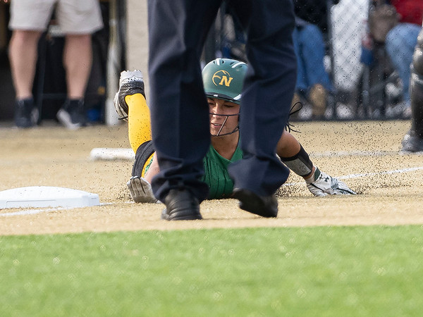 Northridge's infielder  Makena  Knepp (4) slides into seconds base during Tuesday's regional game at Penn High School in Mishawaka.